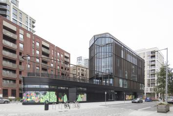 GLASSOLUTIONS brings light to Greenwich Peninsula 'modern village hall' with bespoke VS-1 glazing installation