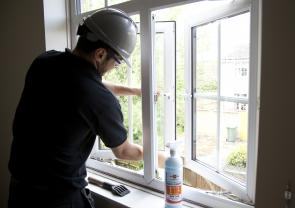 Workman cleaning window